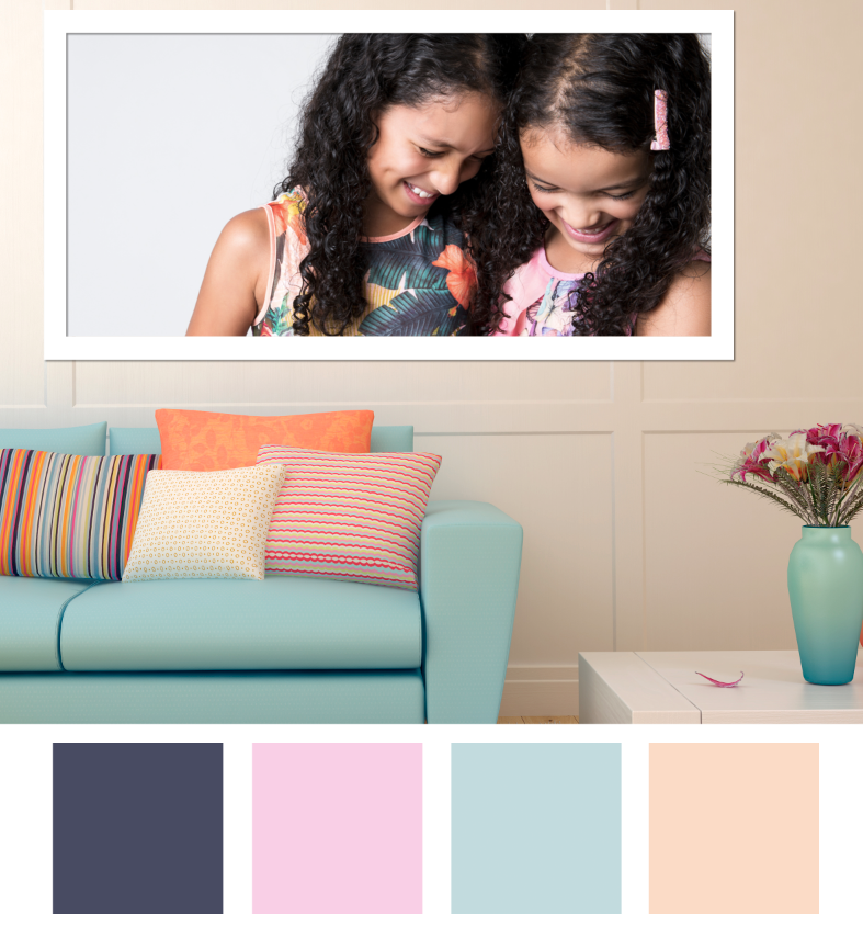 Family photo of two girls, big smiles, displayed at home, showcasing interior design and soft palette. Photographed by Enhance Photography Studios.